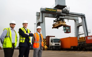 Gethin Worgan, Geoff Tomlinson and Mark Leveridge stand in front of container lift
